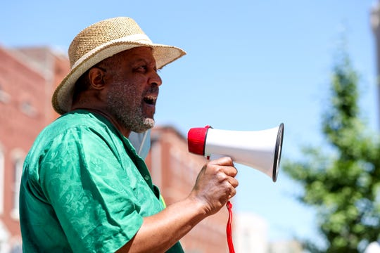 Hopkinsville NAACP President John Banks Jr. speaks to protesters gathered at the Montgomery County Historic Courthouse in Clarksville, Tenn., on Thursday, June 11, 2020.