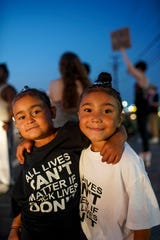 Kalie Stegall, 4, left, and Laylah Stegall, 5, pose for a portrait while at the protest their father organized at the sidewalk across from O'Charley's on Wilma Rudolph in Clarksville, Tenn., on Tuesday, June 9, 2020.