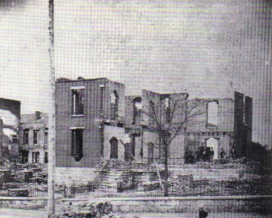 """Ruins of the 1842 Montgomery County Courthouse on Franklin Street after the Great Fire of 1878 in Clarksville, Tenn., from """"Homes & Happenings"""" by Eleanor S. Williams & Ursula S. Beach."""
