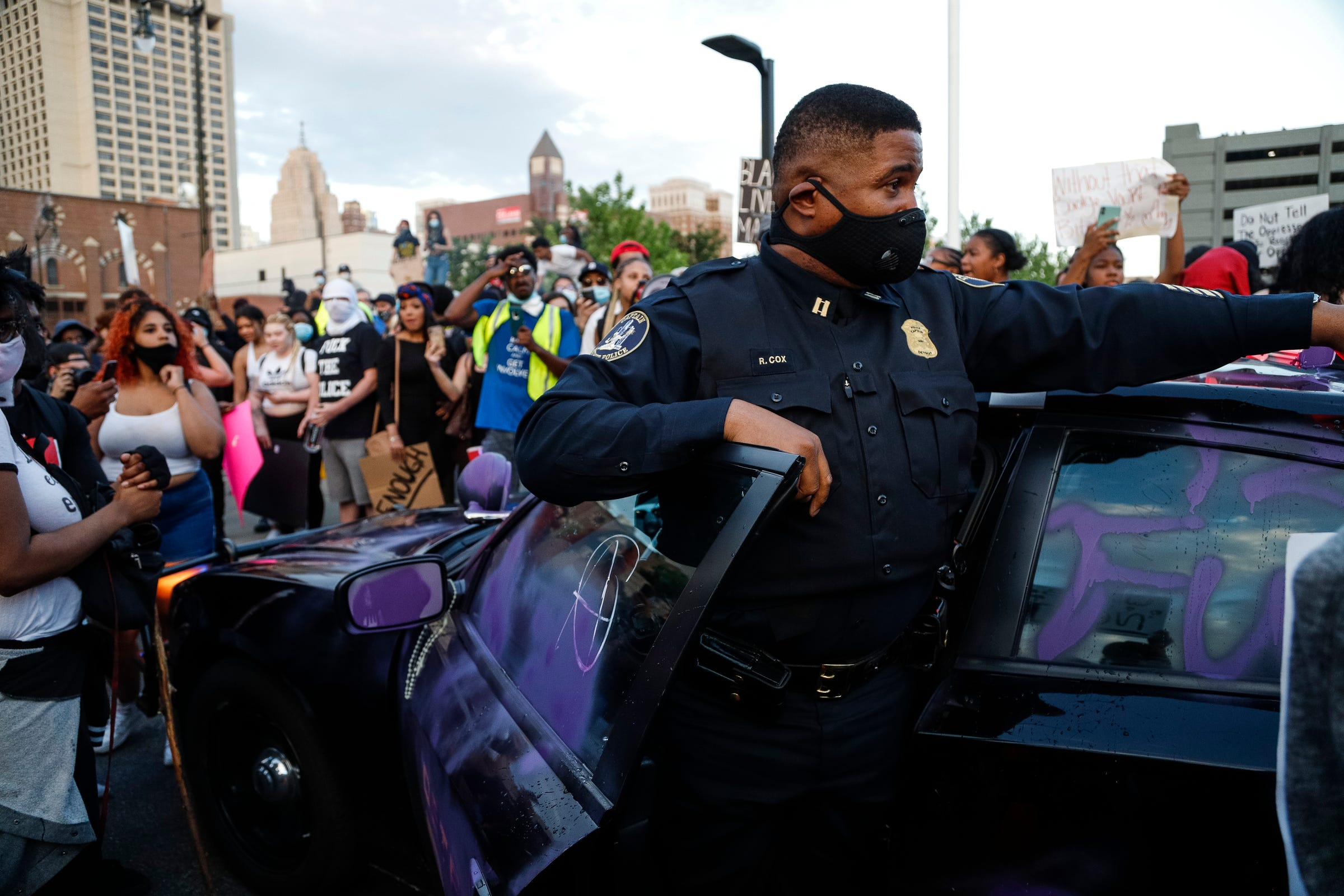 Protesters vandalized a Detroit Police vehicle in front of the Detroit Police headquarters as hundreds gathered and marched through Corktown and downtown to protest police brutality and the death of George Floyd, Friday, May 29, 2020.