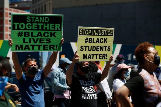 Protesters march through downtown Detroit for the Detroit Public Schools Community District protest on Thursday, June 11, 2020.