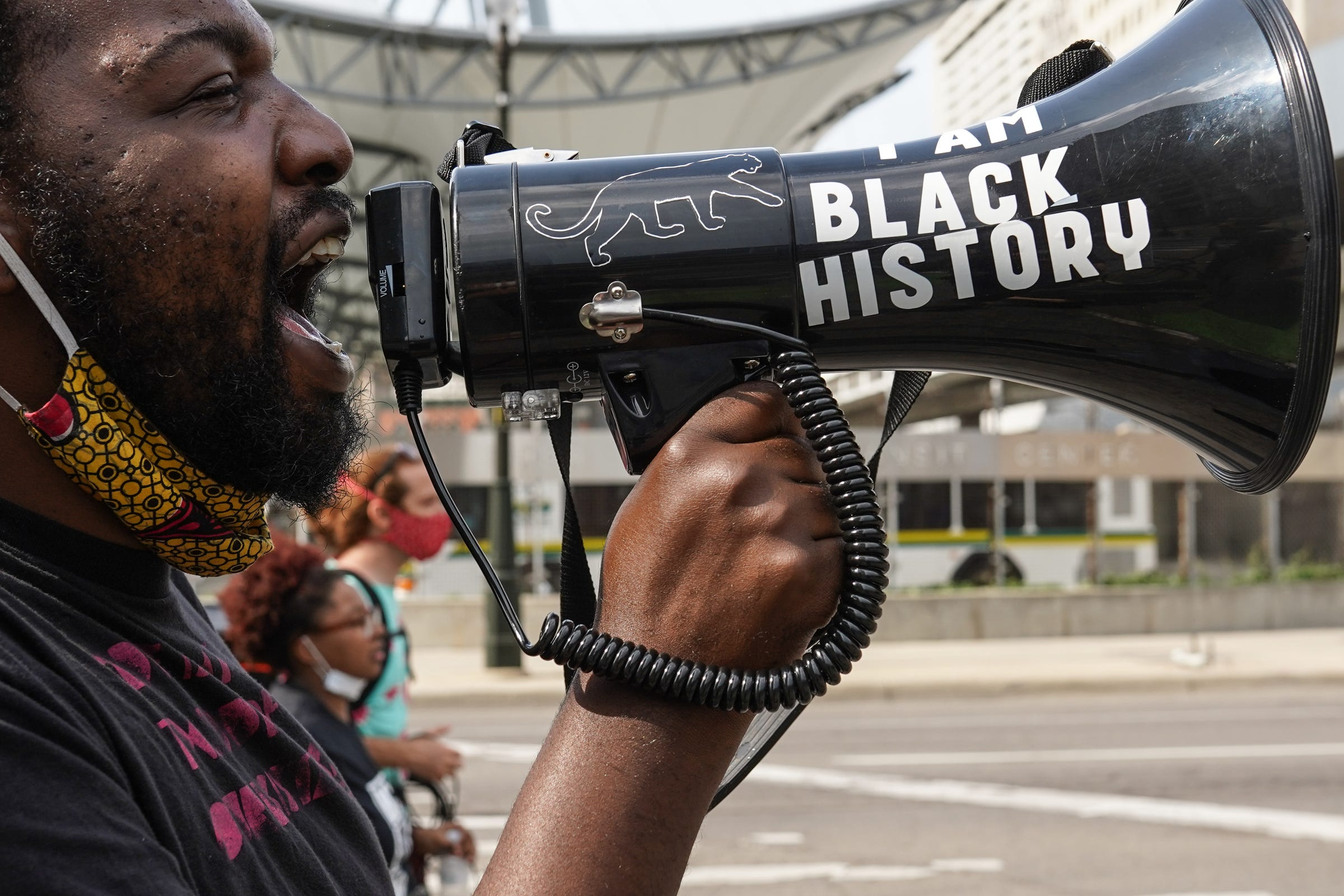 BAMN organizer Tabrian Joe of Detroit chants into a megaphone while leading protesters as they march along Michigan Avenue in Detroit during the thirteenth day of protests against police brutality on Wednesday, June 10, 2020. The protest was cut shorter and had fewer attendees with the heat and threat of a severe thunderstorm.