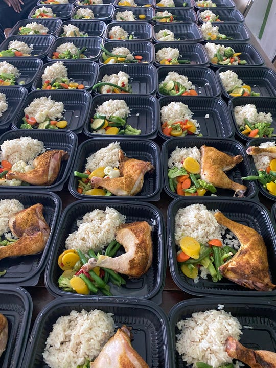 A meal of chicken, rice and vegetables prepared by chef Phil Jones at Oakland Avenue Urban Farm on June 6, 2020, for the Too Many Cooks In the Kitchen For Good initiative.
