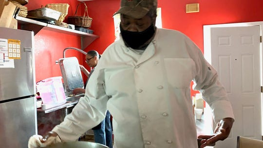 Chef Phil Jones cooking during the COVID-19 pandemic at Oakland Avenue Urban Farm in Detroit's North End neighborhood.