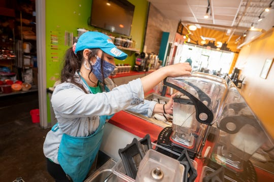 Employee Maddie Forshee makes a customer's drink order at Detroit Bubble Tea, in Ferndale, June 10, 2020.