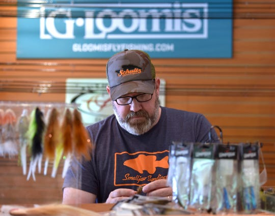 Schultz Outfitters, a fly-fishing shop in Ypsilanti, has had to adapt because of the COVID-19 epidemic. Greg Senyo, store manager, said that when the bar where they usually held weekly fly-tying sessions had to close, the social events moved to Zoom.