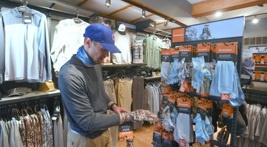 """Chris Grabowski, of South Bend, Indiana, says he's been shopping at Schultz Outfitters for years. """"It's worth the drive. It's probably the best fly shop in the country,"""" says Grabowski, as he shops for a Wyoming destination fly fishing trip he'll be taking in the middle of this summer."""