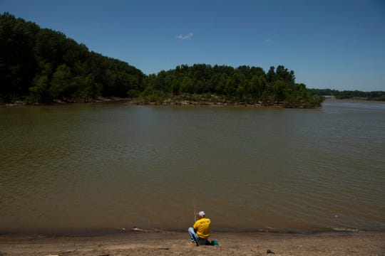 """Danny Glover, 74, of Owensboro, Ky, fishes the Ohio River near the Newburgh Lock and Dam in hopes of catching skipjack shad Wednesday afternoon, June 10, 2020. """"This is my eighth day out of nine coming down here,"""" Glover said, """"But it's been deader than a hammer today,"""""""