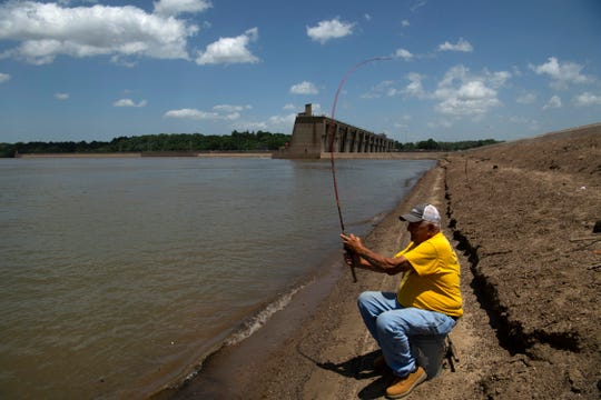 """Danny Glover, 74, of Owensboro, Ky, flips a rig of three jigs into the Ohio River near the Newburgh Lock and Dam in hopes of catching skipjack shad Wednesday afternoon, June 10, 2020. """"This is my eighth day out of nine coming down here,"""" Glover said, """"But it's been deader than a hammer today,"""""""