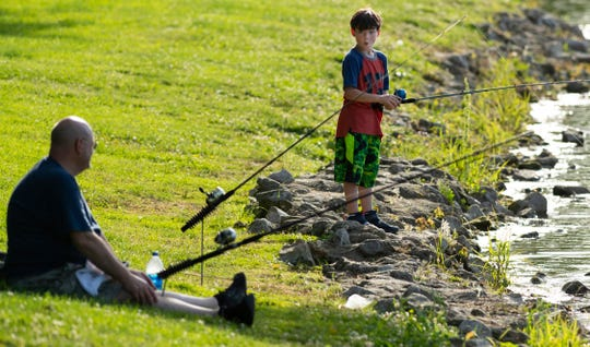 Tucker Eden, 10, of Boonville, Ind., fishes with his granddad, Dave Wallace, at Boonville City Lake Tuesday evening, June 2, 2020. It was the duo's first trip fishing since the COVID-19 outbreak.
