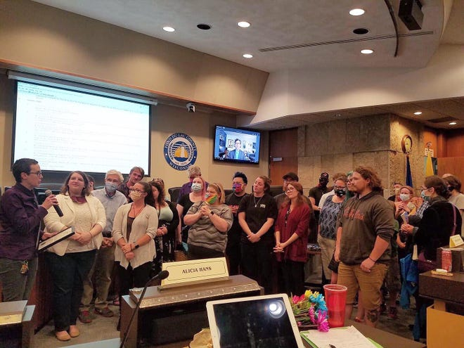 Fond du Lac Pride Alliance President Misty Gedlinske, at left, accepts a proclamation from the Fond du Lac City Council naming June, 2020 as LGBTQ+ Pride Month, surrounded by members of the LGBTQ community and their allies.
