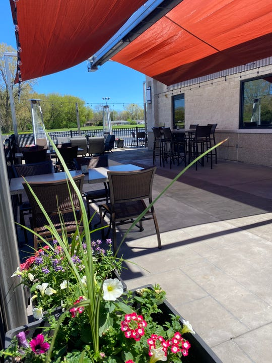 The patio at 1951 West has fire tables, container plantings, a fire pit and portable heaters.