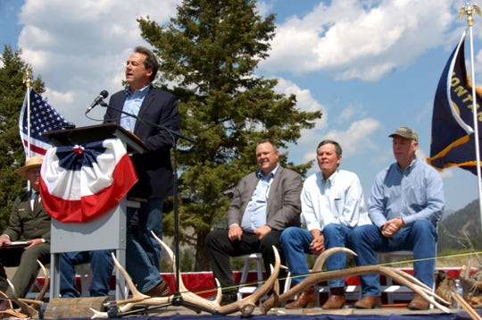 In this Aug. 17, 2017 file photo, Montana Gov. Steve Bullock, Sen. Jon Tester (D-Mont.), Sen. Steve Daines (R-Mont.) and Rep. Greg Gianforte (R-Mont.) are seen at an event marking a conservation agreement at a former mining site in Jardine, Mont. Steve Bullock never got to square off directly against President Donald Trump before dropping out of the Democratic presidential primary race last year. But the two-term governor is getting another chance on his home turf by trying to oust a strong Trump ally, first-term Republican Sen. Steve Daines in Montana's U.S. Senate race. (AP Photo/Matthew Brown)