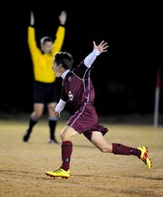 Henderson County's Alex Farmer celebrates a first half goal as the Henderson County Colonels play the Heath High School Pirates Monday evening in West Paducah for the state sub-sectional game.