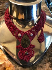 A red micro macrame necklace is among Kathleen Makupson's designs.