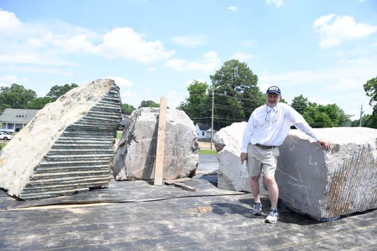 Local Artist, Aaron Lee Benson stands on top of a hill with his sculptures in progress, at Shirlene Mercer Park, in Jackson, Tenn., June, 3, 2020.  The sculpture is to be seven pillars to represent prominent African-Americans in the history of Jackson-Madison County.