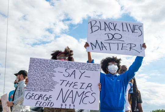 Lateya Mathews and Ashley Worthan participate in a peaceful protest at Old Hickory Mall in Jackson, Tenn., on June 10, 2020. The protest was on North Highland Avenue, then moved to City Hall.