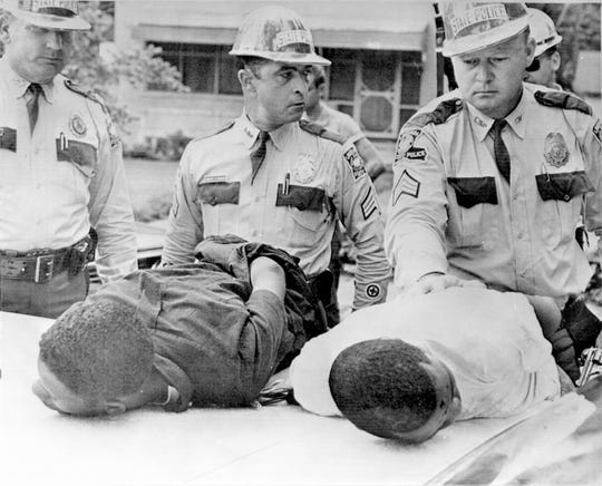 In July 1965, Deacons for Defense and Justice Henry Austan, 21, left, and Milton Johnson, 26, were arrested by Louisiana state troopers after Austan shot Alton Crowe, a white man, during a civil rights demonstration in Bogalusa, La. Austan, who was never brought to trial, now lives in New Orleans.