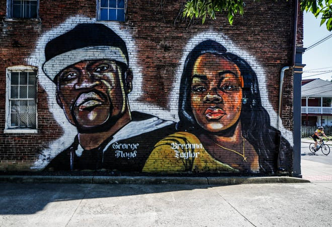 A mural of George Floyd and Breonna Taylor can be seen on the side of renowned sculpture artist Ed Hamiliton's building at 543 S. Shelby Street in Louisville. June 11, 2020