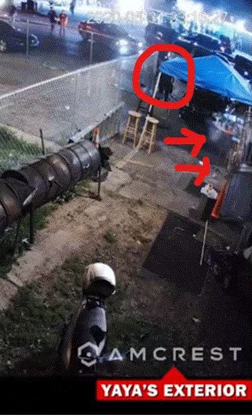 LMPD Officer Katie Crews crosses 26th Street and shoots pepper balls at YaYa's BBQ, as shown in surveillance footage.