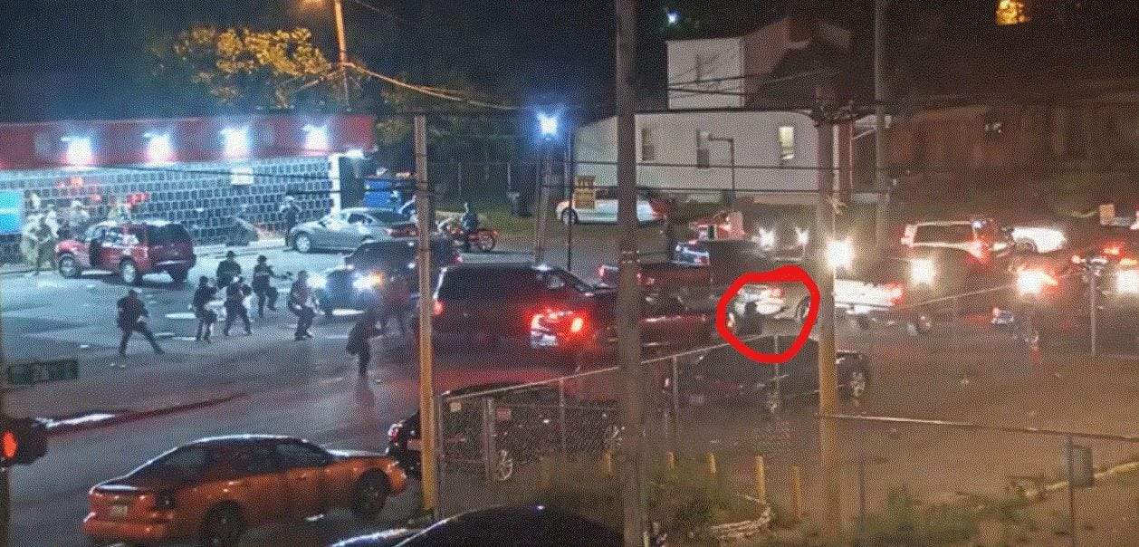 LMPD Officer Katie Crews, while shooting pepper balls at YaYa's BBQ, appears to change weapons, as shown in street surveillance video the night David McAtee was killed by the National Guard in his doorway.