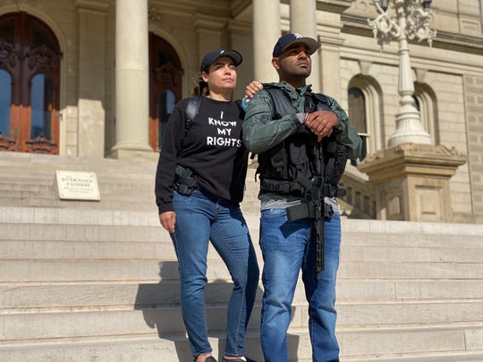 Michael Lynn Jr., right, and his wife Erica, stand on the steps of the State Capitol last month after helping to escort State Rep. Sarah Anthony into the building.