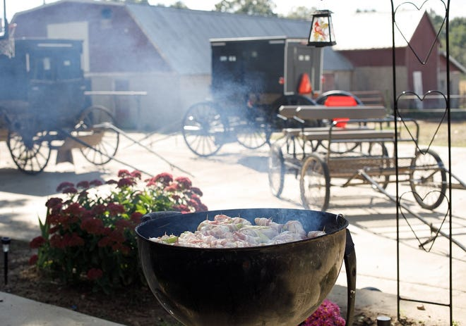 Lovina's family enjoyed supper cooked on the grill following a busy day at Amish garage sales.  Photo submitted by Lovina Eicher.