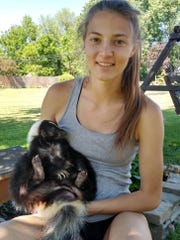 Galion track All-American Kerrigan Myers with the family's pet skunk, Sammy