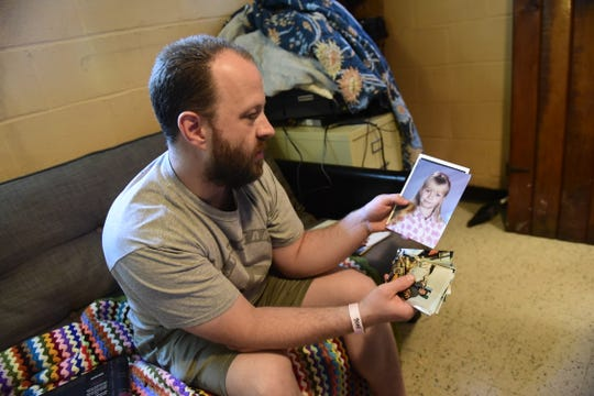 Josh Boggs looks through childhood photos of his late wife, Stacey.