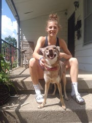 Galion track star Kerrigan Myers with the family's pet coyote Avery