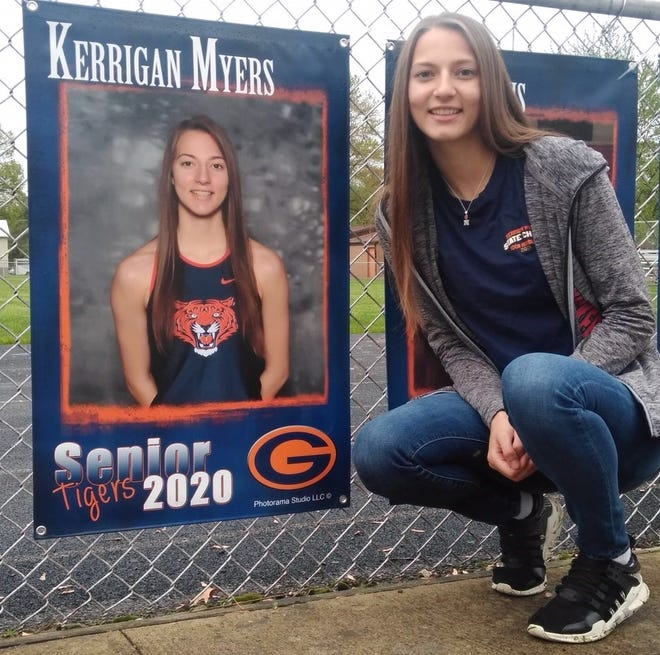 Galion's three-time state track champion and All-American Kerrigan Myers with her banner pinned to the fence at Heise Park, honoring members of the 2020 senior class.