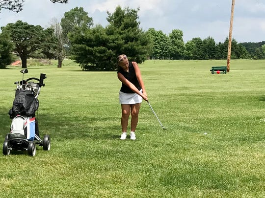Lucy Myers of Colonel Crawford chips onto the seventh green at Green Acres Wednesday in the opening tournament of the 2020 season for the Heart of Ohio Junior Golf Association.