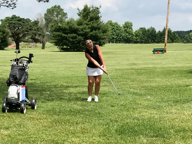Lucy Myers chips onto the green in a Heart of Ohio Junior Golf Association tournament stop at Green Acres last summer.