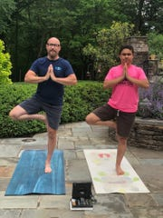 Robert Nielsen teaches yoga classes for Kids2Kids, including his 21-year-old son, Dylan.