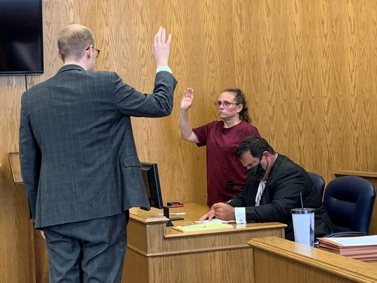 Danielle Stewart (center) raises her hand to be placed under oath for a court hearing on Thursday, June 11, 2020. Stewart was charged with one count of obstructing justice in connection to a Columbus man's death earlier in 2020.