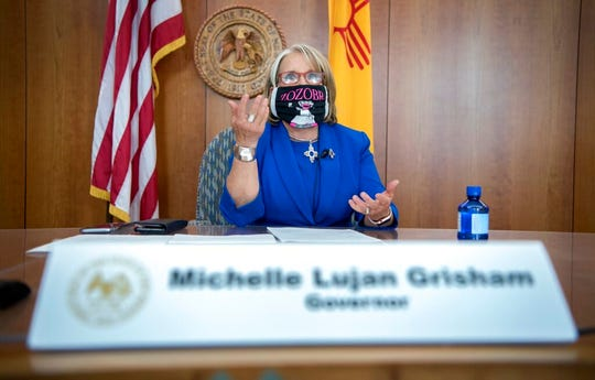 New Mexico Gov. Michelle Lujan Grisham holds a news conference about racism in New Mexico, at the state Capitol in Santa Fe, N.M., Thursday, June 4, 2020.