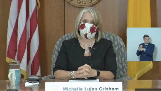 New Mexico Gov. Michelle Lujan Grisham, wearing a cloth face mask, opens a virtual news conference from the state Capitol building in Santa Fe on Thursday, June 11, 2020.