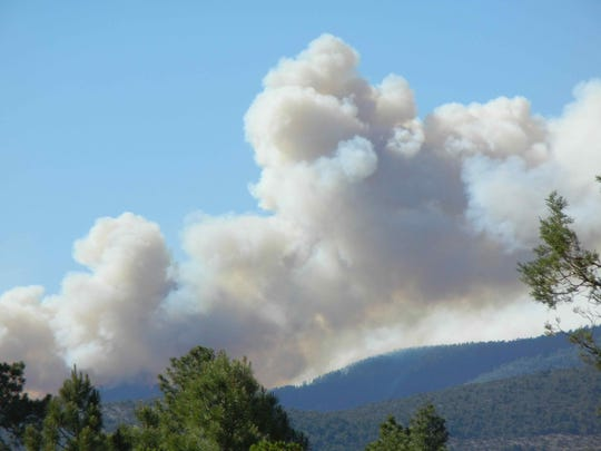 Smoke from the Tadpole Fire in the Gila National Forest is seen from Pinos Altos June 10, 2020.