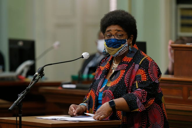 Assemblywoman Shirley Weber, D-San Diego, wears a face mask as she calls on lawmakers to create a task force to study and develop reparation proposals during the Assembly session in Sacramento, Calif., Thursday, June 11, 2020. The Assembly approved the bill that now goes to the Senate.