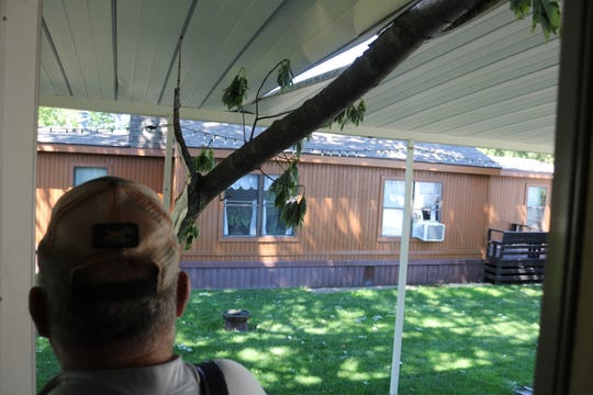 The view from Tom Avery's backdoor of his home in Elmore shows another close call he has had after a tree branch again fell on his roof during strong thunderstorms.