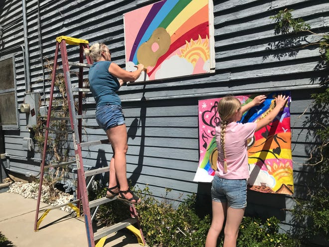 On June 9, 2020, Lorna Denton (left) and daughter Millie Denton (right) help to beautify the Mountain Music Parlor where Millie Denton takes ukulele lessons.