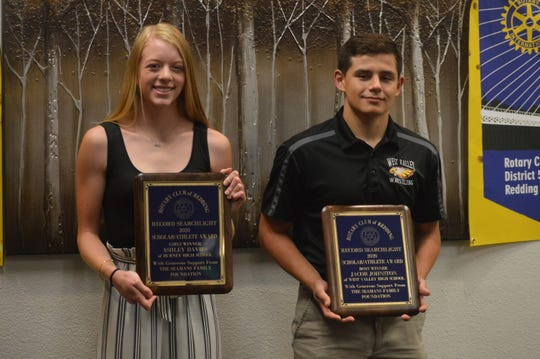 Scholar Athlete of the Year winners Ashley Davies of Burney (left) and Jacob Johnston of West Valley (right) show off their plaques at the Rotary Club of Redding luncheon at C.R. Gibbs American Grille on Thursday, June 11, 2020.