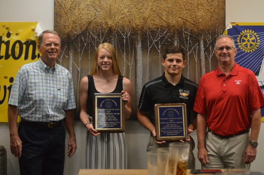 From left to right, Redding Rotary Club member Ken Seamans stands with 2020 Scholar-Athlete of the Year winners Ashley Davies of Burney, Jacob Johnston of West Valley and Rotary Club of Redding president Jeff Avery during the Rotary Club of Redding Luncheon held at C.R. Gibbs American Grille on Thursday, June 11, 2020.