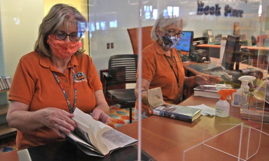 Renee Peel, left, and Alicia Guevara work at the circulation desk at the Stephens Central branch of the Tom Green County Library System on Thursday, June 11, 2020.