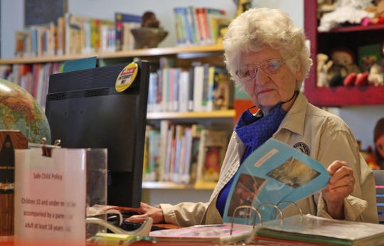 Sally Meyers works in the children's section at the Stephens Central branch of the Tom Green County Library System on Thursday, June 11, 2020.