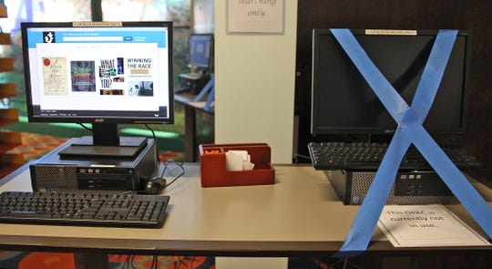 A computer is taped off to encourage social-distancing at the Stephens Central branch of the Tom Green County Library System on Thursday, June 11, 2020.