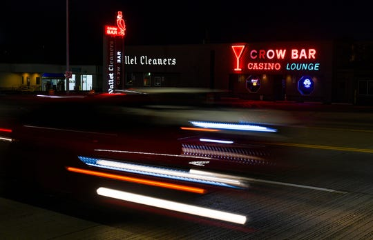 Traffic drives past The Crow Bar on Wednesday night, June 10, on Minnesota Ave. in Sioux Falls.