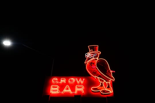 The Crow Bar's signature neon sign lights up on Wednesday night, June 10, on Minnesota Ave. in Sioux Falls.