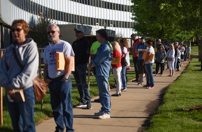 A line of people extends to the sidewalk as the County Administration takes measures to adhere to social distancing at 8 a.m. on Thursday, June 11, 2020 at the County Administration in Sioux Falls.