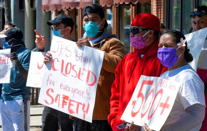 JBS workers protest Tuesday, June 9, 2020, in Logan, Utah. Hundreds of workers at the meatpacking plant in Hyrum, Utah have tested positive for COVID-19. (Eli Lucero/The Herald Journal via AP)